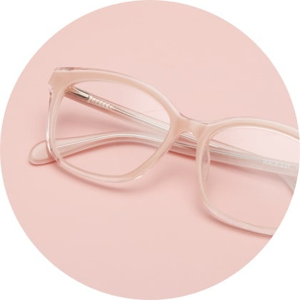 Zenni cat-eye glasses #4445333 in sand, on a pink background.