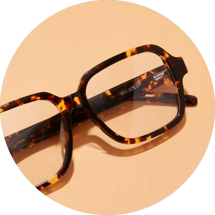 Tortoiseshell square glasses #4444325 on a light orange background.