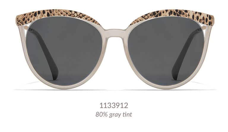 These sophisticated cat-eye sunglasses feature a snakeskin pattern along the top rim. Made with lightweight, translucent TR90 plastic, the wide frame has large rounded lenses. Shown in brown with 80% gray tint.