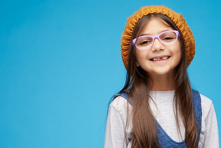 Young girl with long brown hair and slouchy mustard yellow beanie hat wears kids' flexible frame #2021217 in purple.
