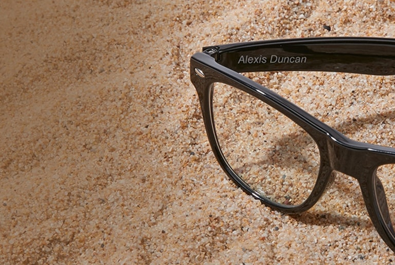 Black kids' square glasses #208321 engraved with 'Alexis Duncan' on inside temple arm.
