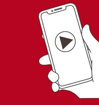 Illustration of a hand holding a smart phone with a video play button on the screen.