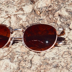 Desert Collection Zenni glasses in the sun on the rocks