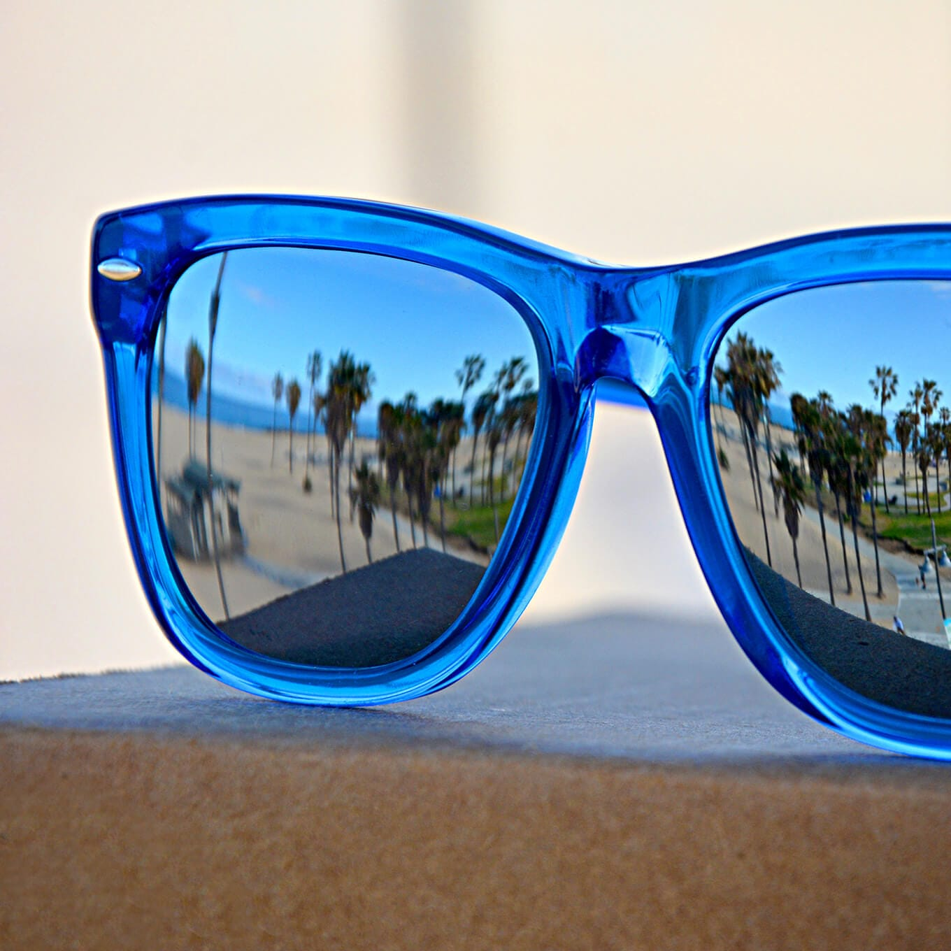 Olvera square acetate sunglasses in bright blue with mirror tint.