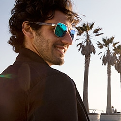 Sunset aviator sunglasses in brushed gold metal with green mirror tint lenses.