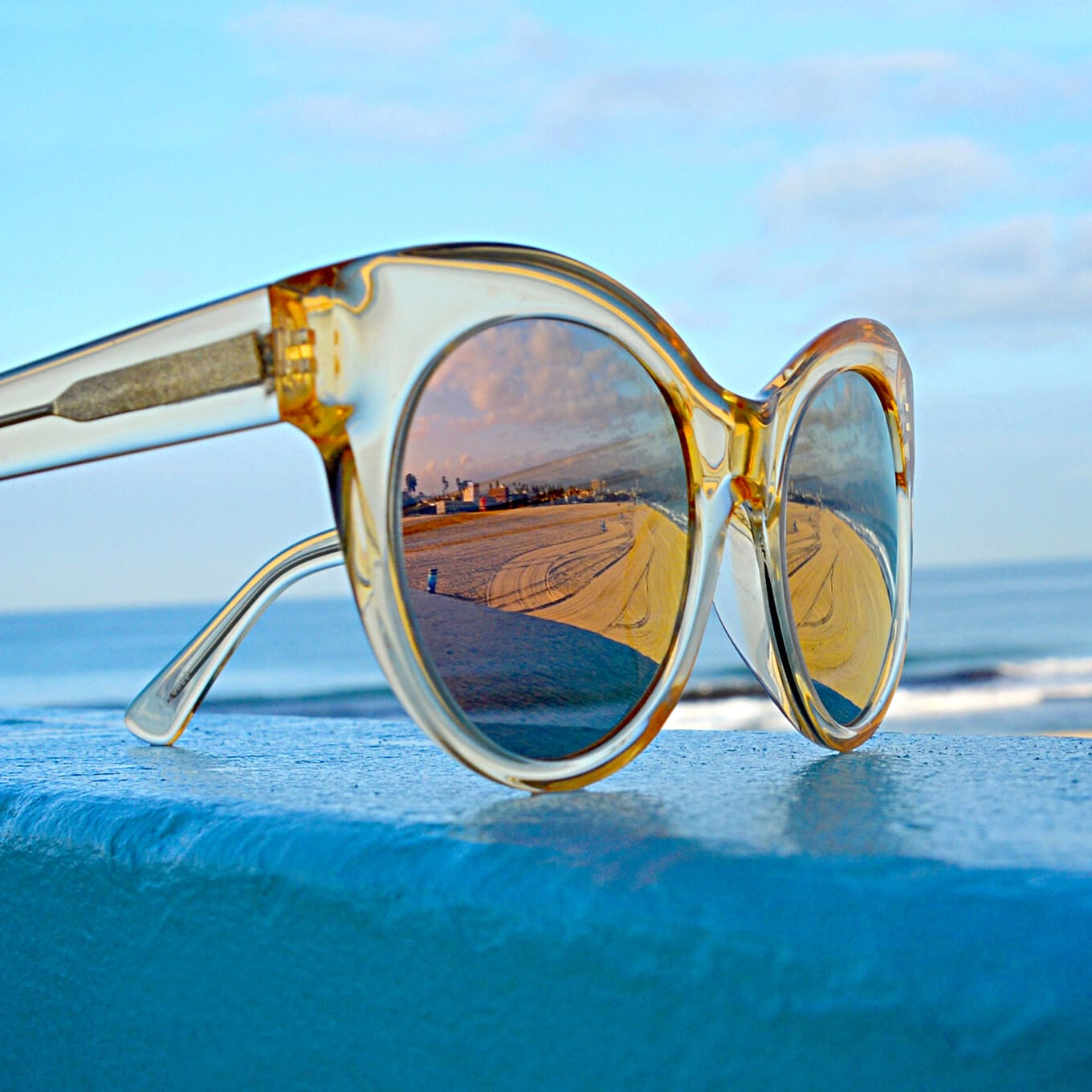 Venice cat-eye acetate sunglasses in translucent yellow with silver mirror tint.