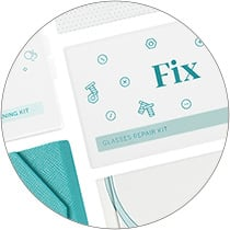 Lay-down image of Zenni deluxe tri-fold case in teal surrounded by Wash & Dry cleaning spray kit, Fix repair kit, and Clean individual lens wipes.
