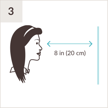 Illustration of woman facing a mirror eight inches away.
