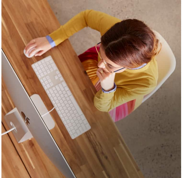 Woman wearing glasses, using computer