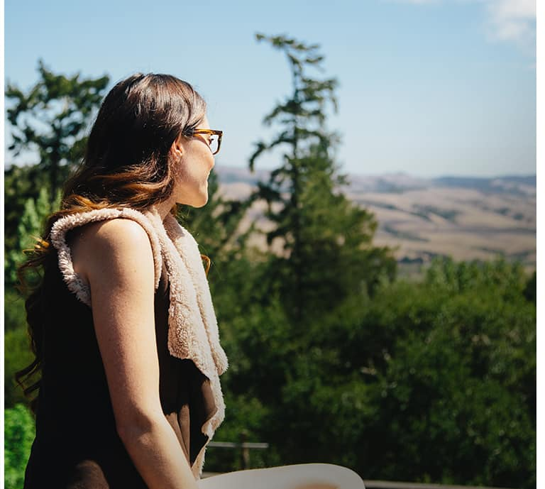 Woman wearing glasses outdoors