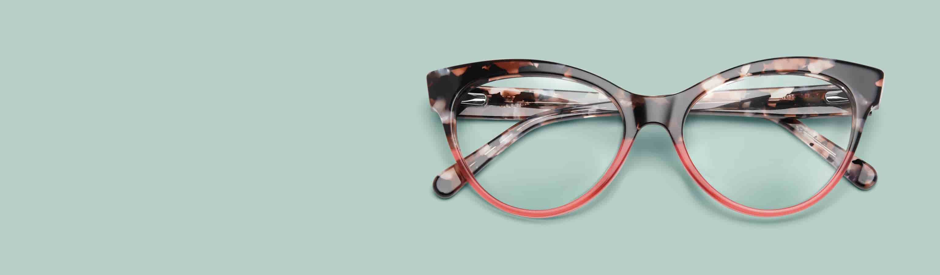 Cat-eye glasses #4434139 with two-tone pattern of tortoiseshell top rim and pink bottom rim with mint green background.