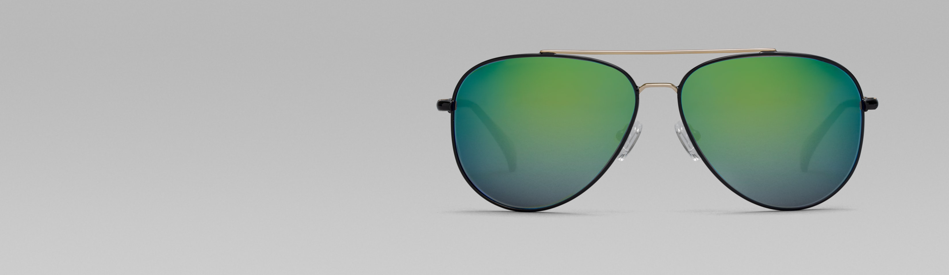 Rotating image of Zenni Premium Aviator Sunglasses #1126721 in black with tinted lens (yellow and lavender tint) and mirror coating options (indigo blue, moss green, and lavender mirror).